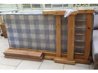 Pine single bed with mattress.
