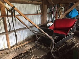 old wooden horse drawn sled