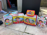 Dora The Explorer Bumper Pack. 32 DVD's and 32 magazines to match. Back pack. Lunch Box. Books