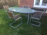 Garden table and 4 armchairs