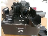 Fujifilm X-T1 with 18-55mm lens and leather case