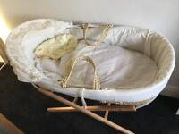 Babie Moses basket and stand,good condition, comes with blankets,sheets and bedding,smoke free home