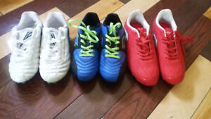 3 pairs of soccer cleats and two pair of shin pads