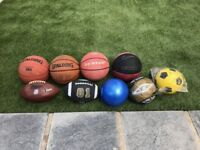 Bundle of footballs and rugby balls