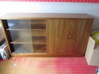 bookcase with sliding glass doors and side cupboard