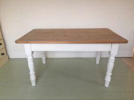Kitchen farmhouse family wooden pine table.