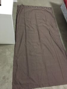 Brown curtains with grommets