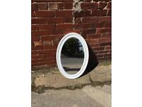 White plastic oval mirror
