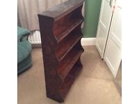 Wooden bookcase with carved detail