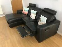 Black leather chaise sofa, manual recliner.