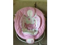 Pink baby's vibrating chair