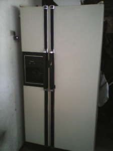 Side by side fridge and freezer with ice maker