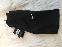 Black Nike tracksuit bottoms. Age 6-8