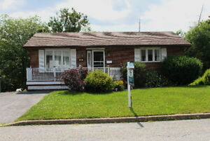 WELL CARED-FOR AND WELL-LOVED BUNGALOW IN FOREST HILLS