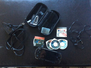 Sony PSP with 5 games and case