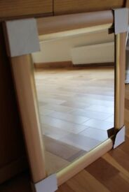 BRAND NEW MIRROR WITH WOODEN FRAME.