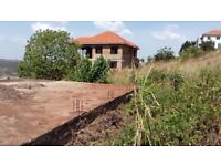 Uganda - Beautiful Plot of Land with Foundation in Entebbe Akright Estates