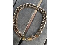 Heavy solid 9ct gold curb bracelet