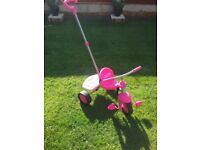 Pink trike with removable handle