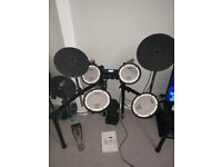 Roland Electric Drum Kit. All mesh heads are tuneable. Fantastic module, great playability