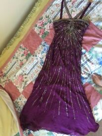 Purple sequinned evening occasion dress