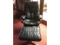 Reclining dark green leather chair with matching footstool. Good condition
