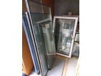 Job lot - uPVC window frames and glazing, various sizes, new and used.