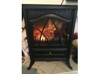 Electric heater with fireplace effect