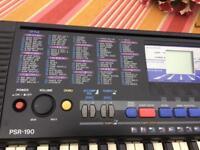 Yamaha PSR-190 Keyboard and black metal X stand