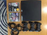 PS3 console + 3 wireless controllers + 2 games + all leads