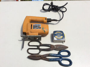Jig saw tape measure and two pair of tin snips