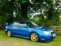 Subaru Impreza WRX STI, 2003-03. One former keeper, 64,000 miles, FSH.
