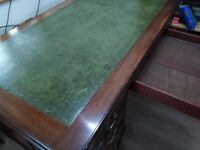 Knee hole Desk with green leather inlaid top, 6 drawers and brass casters