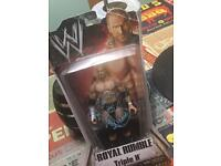 SIGNED TRIPLE H 2010 FIGURE (BOXED)