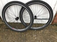 "A pair of Rodi 26"" Aluminium mountain bike wheels, tyre and tubes."