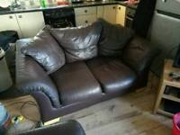 Two seater leather couch and two single seater leather chairs, 3 piece suite