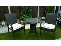 Small round patio table and two chairs