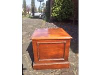 antique commode with ceramic chamber pot and lid inside