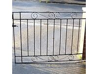 lovely pair of wrought iron low black gates ideal for driveway or garden.