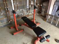 Weight bench, squat bar stand.