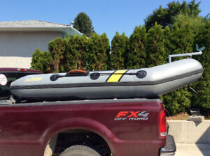 Inflatable POLARIS 10 foot tender and 15 hp Yamaha outboard.