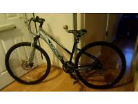 Women's Carrera Crossfire Hybrid bike, helmet (never worn), lights and lock. Perfect condition