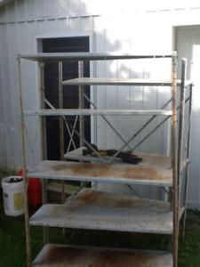 Three metal storage shelfs