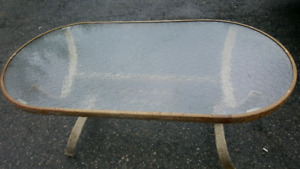 PRICE DROP, URGENT PICK UP. GLASS PATIO TABLE.