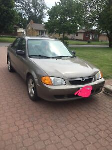 Mazda Protege with parts for safety, winter and summer tires