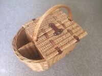 Vintage wicker picnic basket with wine holders