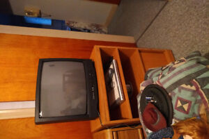 Small TV and stand flat screen and corner unit, wing chair,