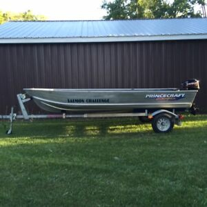 !4' Princecraft aluminun Boat/motor and trailer.VERY LOW HRS.