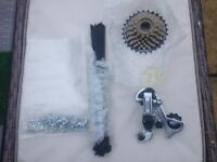 Brand new shimano 6 speed derailleur/cassette and spokes,never used