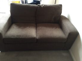 Two two-seater brown fabric sofas